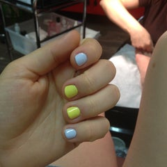 Photo taken at Express Nails by Ksenia S. on 5/12/2013