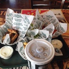 Photo taken at Wingstop by Angela on 5/2/2014