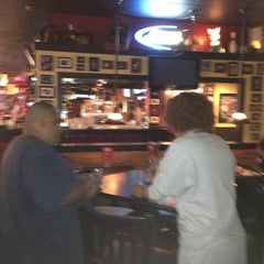 Photo taken at America's Bar and Grill by Michelle C. on 9/10/2013