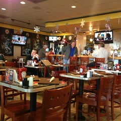 Photo taken at Hall of Fame Sports Grill by Rebecca F. on 12/27/2012