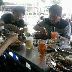 Photo taken at Ayam Penyet Suroboyo by Izard M. on 6/12/2013