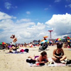 Photo taken at Coney Island Beach & Boardwalk by Kirsten A. on 7/4/2013
