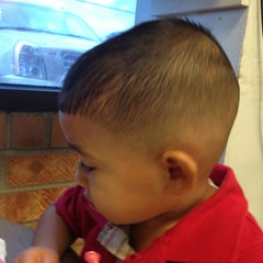 Photo taken at Suki's Hot Cuts by Miguel on 8/28/2013