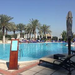 Photo taken at Hilton Dubai Jumeirah Resort by Bea H. on 3/15/2013