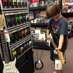 Photo taken at Guitar Center by Bill B. on 2/2/2013