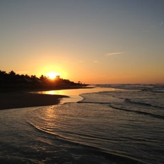 Photo taken at Playa Bonfil by Alan O. on 1/1/2013
