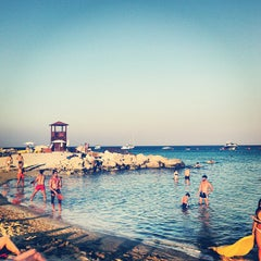 Photo taken at Konnos Beach by Alexander P. on 7/21/2013