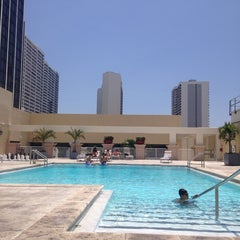 Photo taken at Hilton Hotel Rooftop Pool by Allan M. on 6/29/2014
