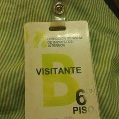 Photo taken at Dirección General de Impuestos Internos (DGII) by Hamilton F. on 2/13/2014