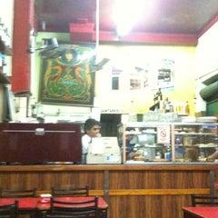 Photo taken at Pizzeria Mi Tio by Gaston G. on 4/24/2011