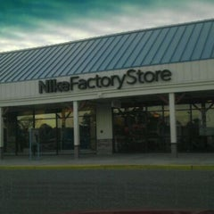 Photo taken at Nike Outlet Store by GEE P. on 12/19/2011