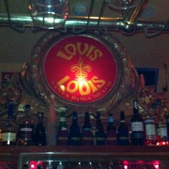 Photo taken at Louis Louis by Angie T. on 7/4/2012