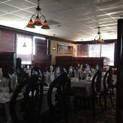 Photo taken at India Palace Restaurant by Tim W. on 12/19/2011