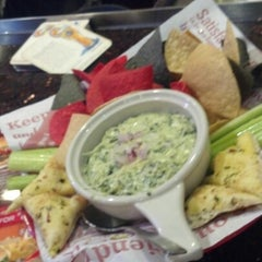Photo taken at Red Robin Gourmet Burgers by Crystal L. on 11/28/2012