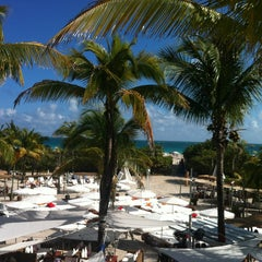 Photo taken at Nikki Beach Miami by Orange S. on 1/6/2013
