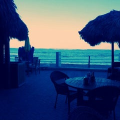 Photo taken at Bamboo Beach Tiki Bar & Cafe by Chris H. on 2/17/2013