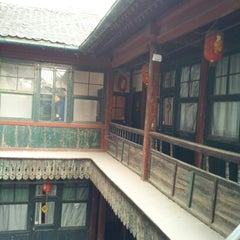 Photo taken at Qianmen Hostel by KwAn P. on 12/27/2012