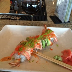 Photo taken at Sushi Hana Fusion Cuisine by Sandy G. on 3/26/2015