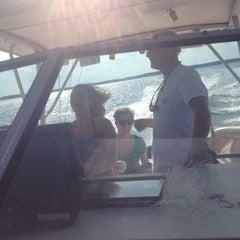 Photo taken at Sandy Point by Julia B. on 9/1/2014