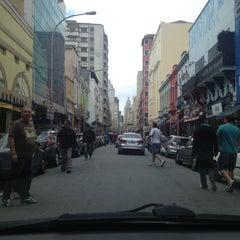 Photo taken at Rua Santa Ifigênia by Nikolas P. on 11/17/2012