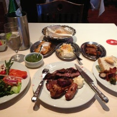 Photo taken at Fogo de Chao Brazilian Steakhouse by M S. on 12/30/2012