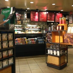Photo taken at Starbucks by Jean Y. on 1/1/2013