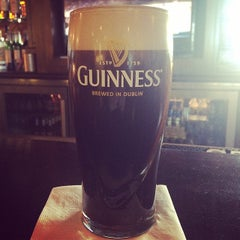 Photo taken at Tigín Irish Pub & Reataurant by Shawna M. on 5/26/2014