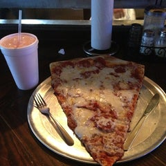 Photo taken at Momo's Pizza by Bruce C. on 1/2/2013