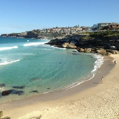 Photo taken at Tamarama Beach by Flavinha Y. on 9/4/2013