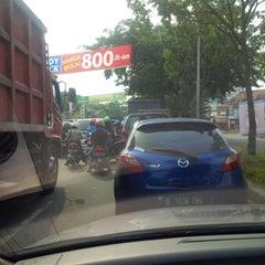 Photo taken at Jalan Raya Alternatif Cibubur (Trans Yogie) by vie d. on 4/30/2014