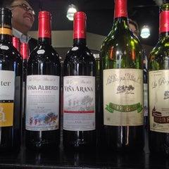 Photo taken at Pogo's Wine & Spirits by Brad M. on 6/11/2014