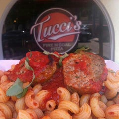 Photo taken at Tucci's Fire N Coal Pizza by Julie on 8/23/2013