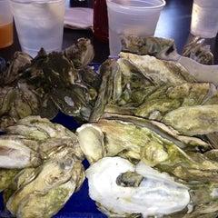 Photo taken at Bowen's Island Restaurant by Erin W. on 3/28/2013