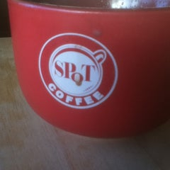 Photo taken at SPoT Coffee Elmwood Cafe by Jonathan E. on 1/1/2013