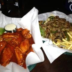 Photo taken at Boss Bar by Dan G. on 12/21/2012