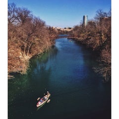 Photo taken at Barton Springs Pedestrian Bridge by Manny H. on 1/17/2014