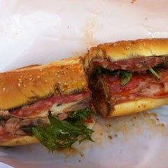 Photo taken at Graham Avenue Meats and Deli by Rev C. on 4/12/2012