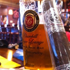 Photo taken at Churchill Cigar Lounge & Wine Bar by James D. on 2/23/2013