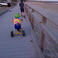 Photo taken at Silver Sands State Park Boardwalk by Maya B. on 8/27/2014