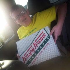 Photo taken at Krispy Kreme Doughnuts by Allison M. on 4/13/2014