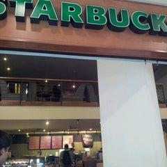 Photo taken at Starbucks by Juliana B. on 12/28/2012