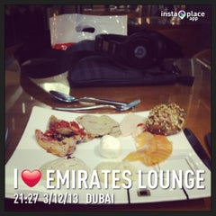 Photo taken at Emirates Lounge by Khaled M. on 3/12/2013