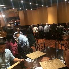 Photo taken at Encasa Restaurant by Ricardo T. on 3/31/2015