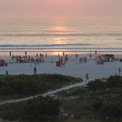 Photo taken at Praia Grande by Mônica N. on 12/31/2012