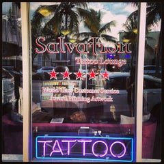 Photo taken at Salvation Tattoo Lounge by Stephanie M. on 11/2/2013