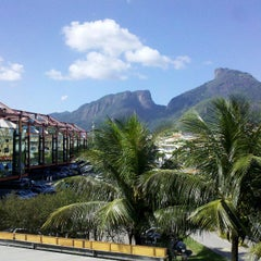 Photo taken at Barra da Tijuca by Amanda S. on 4/17/2013