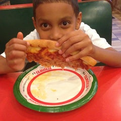 Photo taken at Famous Famiglia Pizza by Daniel M. on 6/13/2013