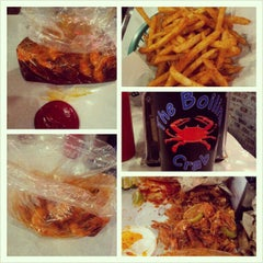 Photo taken at The Boiling Crab by Arie S. on 12/15/2012
