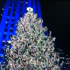 Photo taken at Rockefeller Center Christmas Tree by Rich B. on 11/29/2012