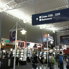 Photo taken at Concourse D by C A. on 10/18/2012